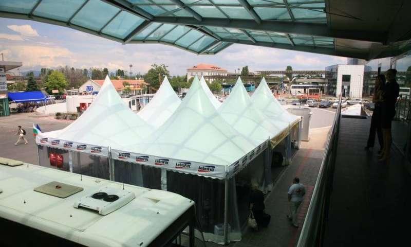 HOW IT ALL WENT DOWN UNDER THE PAVILION TENTS OR HOW TO ORGANIZE A BUS EXPO